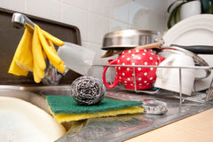 Washing up. Scourer and scrubbing pads in a domestic kitchen Stock Photo