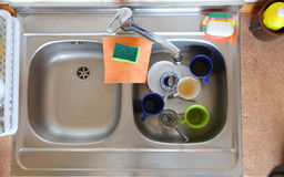 Washing-up bowl in kitchen cup Stock Photo