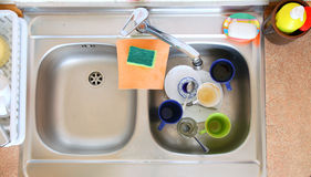 Washing-up bowl in kitchen cup Stock Image