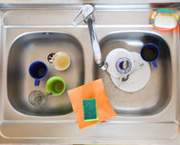 Washing-up bowl in kitchen cup Royalty Free Stock Image