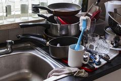 Washing up chores & dirty pots on the kitchen sink. Royalty Free Stock Photo