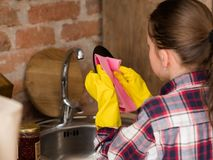 Washing up cleaning dishes dinner housework girl royalty free stock images