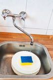Washing-up by cleaning sponge Stock Photos