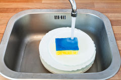Washing-up by dish sponge Royalty Free Stock Photos