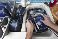 Washing Up Dishes. A kitchen sink full of dirty dishes being washed Stock Photography