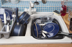 Washing Up Dishes. A kitchen sink full of dirty dishes to be washed Royalty Free Stock Photography