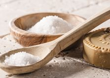 Washing up and hydrating skin for soothing and relaxing body. Bath salt in wooden cup and spoon with soap for cleansing and body rejuvenation Stock Photography