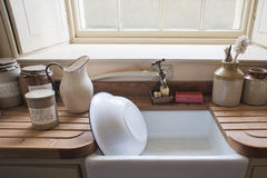 Washing up sink. Old fashioned washing up sink with vintage cannisters Royalty Free Stock Image