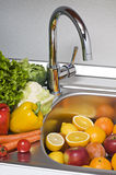 Washing vegetables Stock Photography