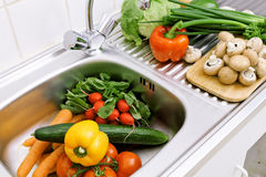 Washing vegetables stock image