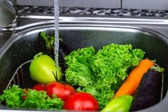 Washing vegetables for cooking, Vegetarian food royalty free stock photos