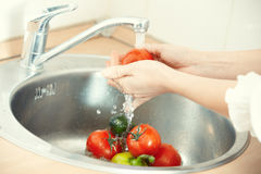 Washing vegetables Royalty Free Stock Photo