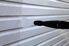 Washing the vinyl siding. Close up royalty free stock photography