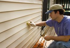 Washing Vinyl Siding of House Royalty Free Stock Image