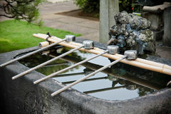 Washing water at Japanese Shrine Stock Photo