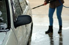 Washing a white car. Women in the background. royalty free stock photo