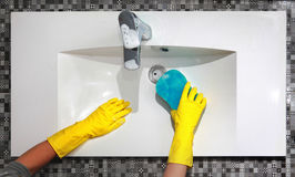 Washing white sink in bathroom Royalty Free Stock Images