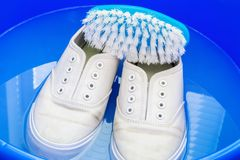 Washing white sneakers Royalty Free Stock Photography