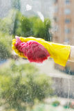 Washing window glass by soapy water Royalty Free Stock Images