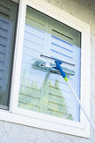 Washing window on a home Stock Image