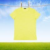 Washing yellow tshirt Stock Photo
