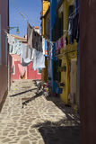 Washings Drying in Colorful Burano, Venice Royalty Free Stock Photos