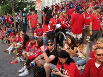 Washington Capitals Fans Gather to See the Game. Photo of washington capital fans gathering near the capital one arena in downtown washington dc on 6/4/18. These royalty free stock photos