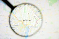 Washington city visualization illustrative concept on display screen through magnifying glass. Washington city visualization illustrative concept on screen stock photo