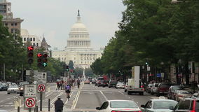 Washington D.C. Capitol Building 1. Looking down Pennsylvania Avenue towards the Capitol building in Washington D.C. on an overcast day stock video footage
