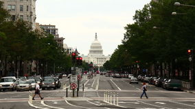Washington D.C. Capitol Time-Lapse Zoom. Looking down Pennsylvania Avenue towards the Capitol building in Washington D.C. Shot in Timelapse, zooming in slowly stock video