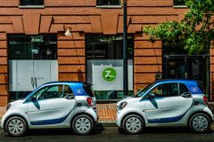 Washington, D.C. - July 20, 2018: Car2Go cars parked in front of Zipcar office royalty free stock photography