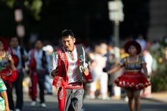 The Fiesta DC Parade. Washington, D.C., USA - September 29, 2018: The Fiesta DC Parade, bolivian man wearing traditional clothing dancing royalty free stock photo