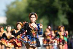 The Fiesta DC Parade. Washington, D.C., USA - September 29, 2018: The Fiesta DC Parade, Bolivian women wearing traditional clothing performing a traditional stock photos