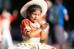 The Fiesta DC Parade. Washington, D.C., USA - September 29, 2018: The Fiesta DC Parade, Young Bolivian girl wearing traditional clothing going down the street stock photography