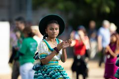 The Fiesta DC Parade. Washington, D.C., USA - September 29, 2018: The Fiesta DC Parade, Young Bolivian girl wearing traditional clothing going down the street stock photo