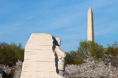 WASHINGTON DC - APRIL 12, 2015: The Martin Luther King Jr Memorial and Washington Monument during cherry blossom in Washington DC. Royalty Free Stock Photography