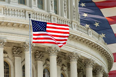 Washington DC Capitol detail with american flag. Washington DC Capitol dome detail on american flag background Royalty Free Stock Photography
