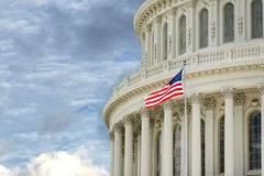 Washington DC Capitol detail with american flag. Washington DC Capitol dome detail on cloudy sky background Stock Photography