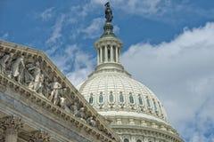 Washington DC Capitol detail on cloudy sky. Washington DC Capitol dome detail with waving american flag Royalty Free Stock Photos