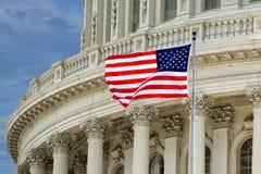Washington DC Capitol detail on cloudy sky. Washington DC Capitol dome detail with waving american flag Stock Photography