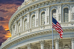 Washington DC Capitol detail on golden sunset background. Washington DC Capitol dome detail with waving american flag Stock Photography