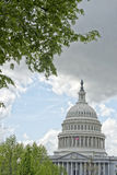 Washington DC Capitol view from the mall on cloudy sky. Washington DC Capitol dome detail with waving american flag Royalty Free Stock Image