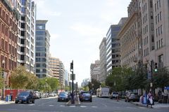 Washington DC city scene at intersection. WASHINGTON DC - AUGUST 20: Image of a DC street scene with highrise buildings vehicles street parking August 20, 2016 Stock Image