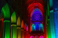 Washington National Cathedral architecture illuminated by lights. WASHINGTON, DC - FEBRUARY 5, 2018: `Seeing Deeper` - Space, Light and Sound event at Stock Photography