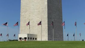 Washington, DC - Flags at the base of the Washington Monument. This is an image of US flags blowing in the wind at the base of the Washington Monument, which is stock footage