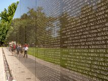 Close up of Vietnam Veterans Memorial with tourists in background on a summer day royalty free stock photos
