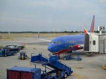 Southwest Airlines plane loading passengers stock photos