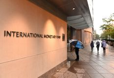 Washington, DC - June 04, 2018: People near the International Mo. Netary Fund, IMF Headquarters 2 Building HQ2 in DC Royalty Free Stock Photography