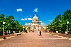 United States Capitol Building in Washington DC - East Facade of the famous US landmark with tourists. stock photography