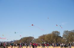 A large crowd of adults and children flying kites at the Kite Festival on the National Mall. WASHINGTON, DC - March 31, 2018: A large crowd of adults and Royalty Free Stock Photo